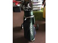 Golf clubs bag balls and trolley
