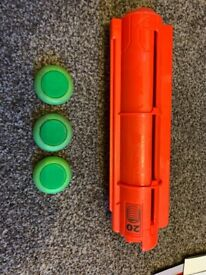 3 nerf discs and dispenser. 2 huge Nerf guns included for free