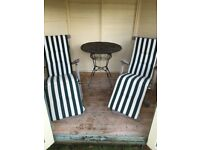 Pair of lovely solid wood sun loungers