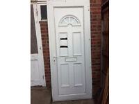 White upvc door with fanlight glass panel in the top,..