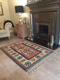 A GENUINE HANDMADE & HAND KNOTTED AKHAN TURKISH WOOL RUG WITH PLATTED FRINGING