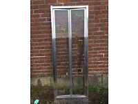 Bi-fold shower door