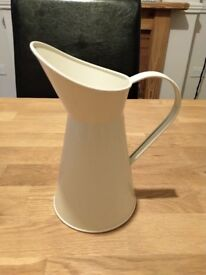 Four cream coloured metal milk jugs, perfect as wedding decorations or for use as vases.