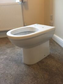 Brand new back to wall toilet pan and seat