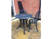 Green metal outdoor bistro table and 2 chairs