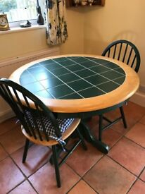 Circular tile top kitchen/dining table and 2 chairs
