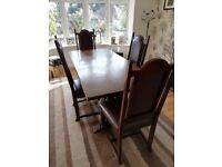 lovely JC dark oak dinning room table and 4 chairs recently reupholstered.