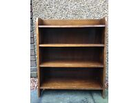 Dark wood sloping bookcase with 3 shelves, H92cm W66cm D25cm max
