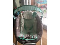 Ingenuity automatic baby bouncer. All parts removable and machine washable. 0-6 months.