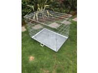XL dog crate, 2 plastic dog beds, 2 car harnesses plus training games