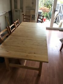 Large pine dining table 220 long extending to 266 cm . 100cm wise there are 8 chairs £75 Ono