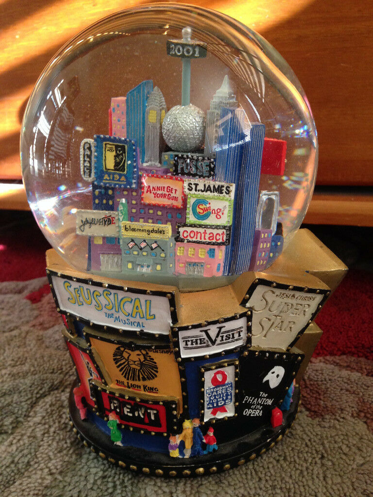 Large Magical 2001 New York and Broadway snow globe plays 'let it snow'