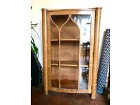 Wooden drinks cabinet retro vintage with curved glass door.