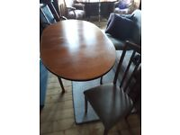 Extendable dining room table plus 4 chairs