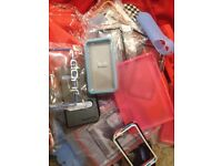 2 bags of Miscellaneous phone cases and iPad and laptop cases all brand new.