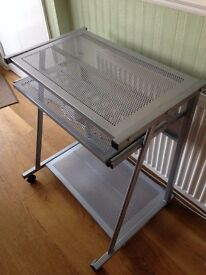 Small computer desk with fold out keyboard tray. Silver colour.