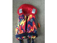 Child's crewsaver life jacket with whistle