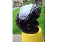 Motorcycle flip up crash helmet made by Nolan size Small