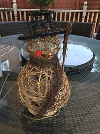 Xmas wicker snowman and lights