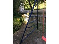 2 swing set with climbing rungs and basketball hoop