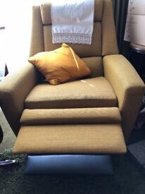 ; chairs total! 2 lazy boy armchairs with foot rests and 2 sturdy armchairs in impeccable condition