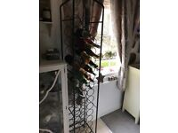 Cast iron wine rack, heavy and tall