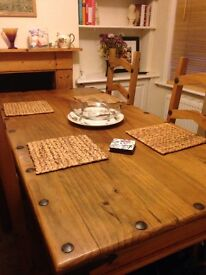 Pine dining room table and four pine chairs