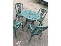 Ornate cast ornate metal table and 4 armchairs heavy patio garden set