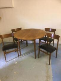 Vintage Danish style teak dining table and chairs