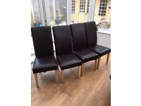 4 leather look brown dining chairs