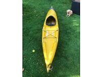 Sea / touring kayak 4m with sealed storage compartment behind seat and open storage on rear deck.