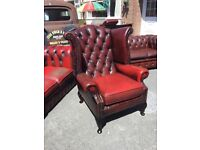 Chesterfield wing back armchair in ox blood red