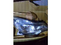 Vauxhall Corsa D driver side light housing unit