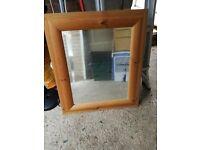 Pine surround mirror.