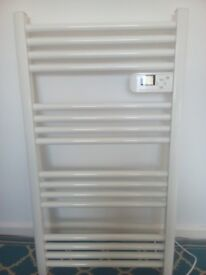 White electric towel rail with digital controls and electronic thermostat
