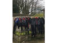 Wet suits and life jackets various sizes