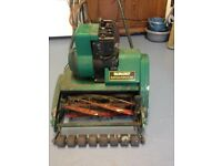 Qualcast Petrol Suffolk punch lawn mower . Needs a service not been used for a while .