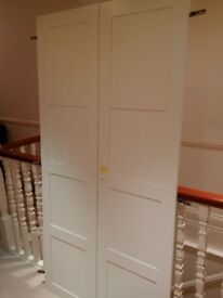 two door wardrobe in white VGC can deliver