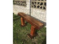 Sleeper garden bench with carved solid oak legs
