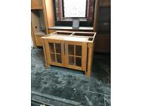Wooden table/cupboards