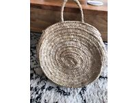 Round basket bag by tidy store