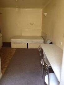 Basement furnished studio flat own kitchen + bathroom,inc council tax & water rates.Central Brighton