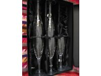 Set of lead crystal champagne glasses in presentation box.