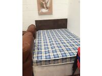 Double bed with brown headboard