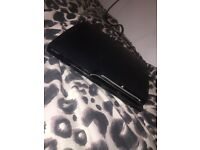 PlayStation 3 (PS3) for sale with a remote and GTA V.