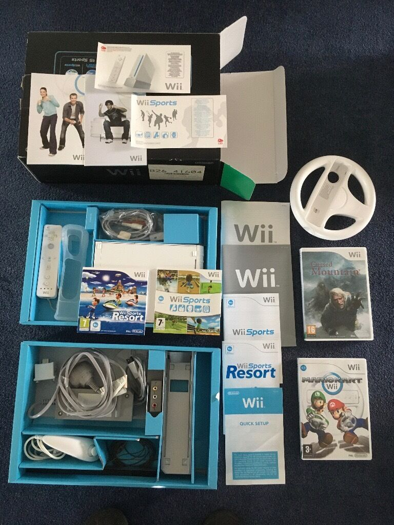 Nintendo Wii with Mario game and steering wheel