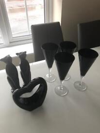 Bundle of black ornaments and glasses