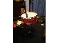 red snare drum and stand