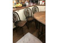 Four vintage wheel back chairs and drop leaf table