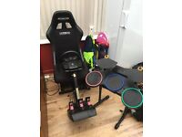 PlayStation gaming chair, PlayStation 3 console, 42 games, 2 guitars and drum set
